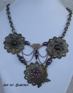 En 70-årspresent med lila pärlor och brons.